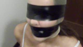BLINDFOLDED AND GAGGED SLAVE TIED UP ON A CHAIR
