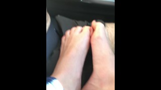 Car Footjob and Cumshot While Driving. She Does All The Work