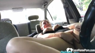 Babe pleases her tight pussy in the car