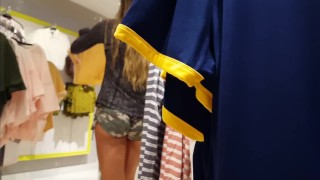 Candid voyeur girl shopping in tiny camo shorts