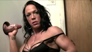 Muscle girl at the gloryhole.