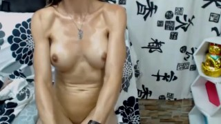 Mila Showing Her Sexy Oiled Muscles