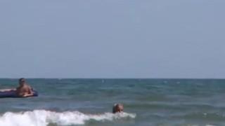 Blonde peeing public beach