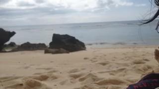 Cute Asian girlfriend sucking on the beach