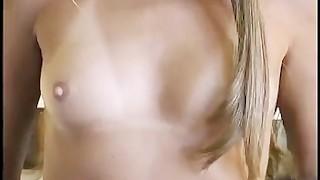 She gives his cock ring clad dick a handjob